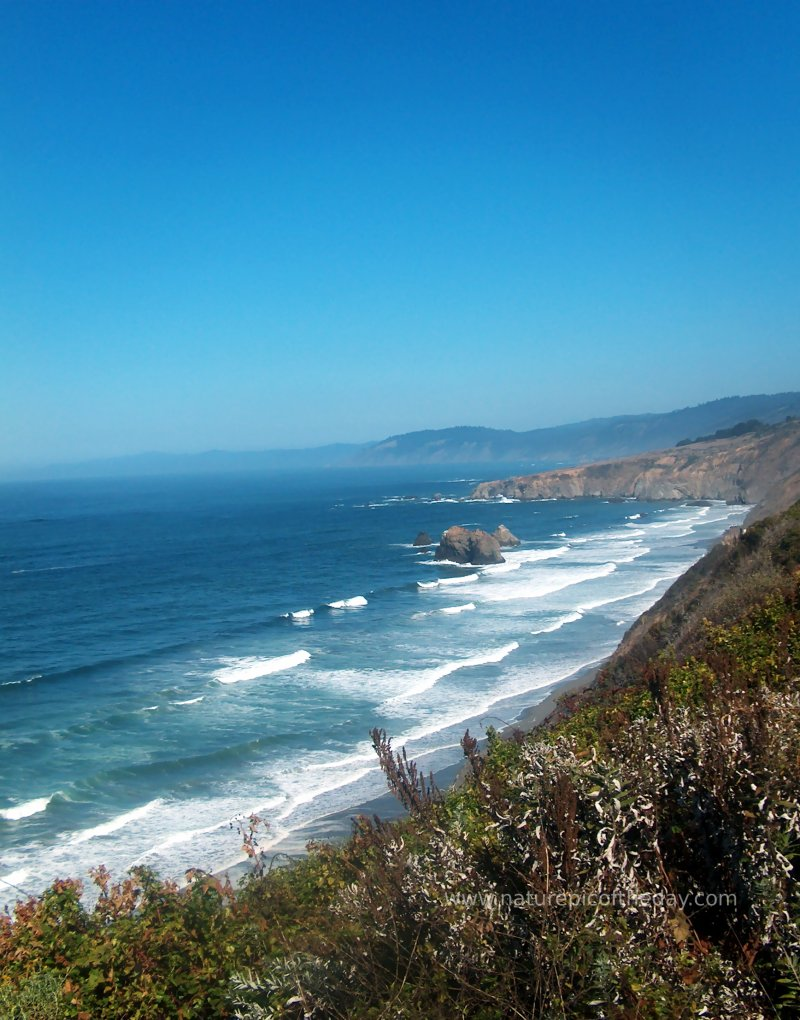 long rolling waves on the coast of northern california.