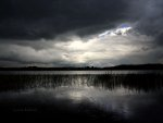Rain storm over lake in Wales.